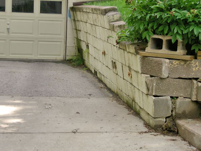 a failing retaining wall around a driveway in Westland