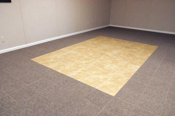 tiled and carpeted basement flooring installed in a Warren home